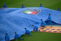 Volunteers appear on the pitch with a giant replica of the Italy jersey ahead of the UEFA EURO 2020 Group A football match between Italy and Switzerland at the Olympic Stadium in Rome on June 16, 2021. (Photo by Riccardo Antimiani / POOL / AFP)