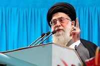 Iran's supreme leader Ayatollah Ali Khamenei speaks during Friday prayers at Tehran University February 3, 2012. Ayatollah Ali Khamenei said on Friday the Islamic Republic would not yield to international pressure to abandon its nuclear course, threatening retaliation for sanctions aimed at Iran's oil exports. REUTERS/khamenei.ir/Handout (IRAN - Tags: POLITICS RELIGION) FOR EDITORIAL USE ONLY. NOT FOR SALE FOR MARKETING OR ADVERTISING CAMPAIGNS. THIS IMAGE HAS BEEN SUPPLIED BY A THIRD PARTY. IT IS DISTRIBUTED, EXACTLY AS RECEIVED BY REUTERS, AS A SERVICE TO CLIENTS