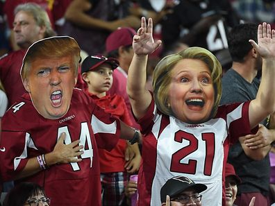 Arizona Cardinals fans wear masks of Presidential candidates Donald Trump and Hillary Clinton during the NFL game between the New York Jets and Arizona Cardinals at University of Phoenix Stadium on October 17, 2016 in Glendale, Arizona