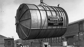 14th March 1949:  A man guides a 10-ton stainless steel fermenting tun, constructed in Leven, Glasgow, as it is hoisted by a crane at Glasgow docks onto the ship 'Lairdsglen' en route to the Guinness Brewery in Dublin. The tun can hold 150,000 pints of Guinness.  (Photo by Reg Speller/Fox Photos/Getty Images)