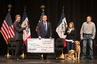 "(FILES) In this file photo taken on January 29, 2016, then Republican presidential candidate Donald Trump (C) joins Jerry Falwell, Jr.(L), president of Liberty University, for a campaign rally at the Adler Theatre where Trump presented a check from the Trump Foundation to the Puppy Jake on January 30, 2016 in Davenport, Iowa. - President Donald Trump has agreed to shut down his personal charity, the Trump Foundation, which has been accused of engaging in ""persistently illegal conduct,"" the New York attorney general said on December 18, 2018. (Photo by SCOTT OLSON / GETTY IMAGES NORTH AMERICA / AFP)"