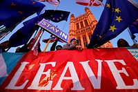 Banners, Union and EU flags are displayed outside the Houses of Parliament in London on October 22, 2019, as MPs debate the second reading of the Government's European Union (Withdrawal Agreement) Bill. - British Prime Minister Boris Johnson faces two crucial Brexit votes Tuesday that could decide if he still has a reasonable shot at securing his EU divorce by next week's deadline. The UK is entering a cliffhanger finale to a drama that has divided families and embittered politics ever since voters backed a split from Britain's 27 EU allies and trading partners in 2016. (Photo by Tolga Akmen / AFP)