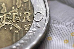 A two Euro coin is pictured next to an English ten Pound note in an illustration taken March 16, 2016.  REUTERS/Phil Noble/Illustration/File Photo