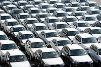 (FILES) This file photo taken on October 2, 2015 shows new cars of German car maker BMW parked ready for shipping at the car terminal of the port of Bremerhaven, northwestern Germany. The German economy grew 2.2 percent in 2017, enjoying its fastest rate of expansion since 2011, official data for Europe's top economy showed on January 11, 2018. / AFP PHOTO / DPA / INGO WAGNER