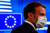 """France's President Emmanuel Macron arrives for a meeting of an EU summit on a coronavirus recovery package at the European Council building in Brussels on July 19, 2020 - An acrimonious EU summit headed into a third day as leaders remained deadlocked over a huge post-coronavirus economic recovery plan, unable to overcome fierce resistance from the Netherlands and its """"frugal"""" allies. (Photo by JOHN THYS / POOL / AFP)"""