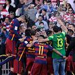 Barcelona's players celebrate their 24th La Liga title at the end of the Spanish league football match Granada CF vs FC Barcelona at Nuevo Los Carmenes stadium in Granada on May 14, 2016. Barcelona sealed their 24th La Liga title as Luis Suarez took his tally for the season to 59 goals with a hat-trick in a 3-0 win at Granada to hold off Real Madrid's late-season surge. / AFP PHOTO / CRISTINA QUICLER
