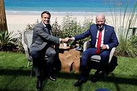 France's President Emmanuel Macron (L) greets Canada's US President Joe Biden before a bilateral meeting during the G7 summit in Carbis bay, Cornwall on June 12, 2021. (Photo by Ludovic MARIN / AFP)
