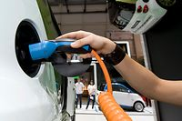 A Smart Electric Drive is plugged in at the Geneva Motor Show in Geneva, Switzerland, Wednesday, March 3, 2010. About 250 exhibitors from 30 countries, showing 100 car premieres at the Auto Show until March 14. (AP Photo/Martin Meissner)