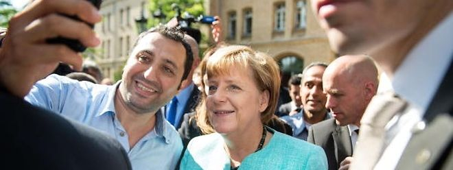 Selfie im September 2015: Rodin Saouan, Flüchtling aus Syrien, Kanzlerin Angela Merkel.