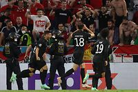 Germany's midfielder Leon Goretzka (2nd R) celebrates scoring his team's second goal with his teammates during the UEFA EURO 2020 Group F football match between Germany and Hungary at the Allianz Arena in Munich on June 23, 2021. (Photo by ALEXANDER HASSENSTEIN / POOL / AFP)