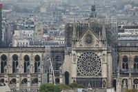 A picture taken on April 16, 2019 shows a general view of Notre-Dame Cathedral seen from the Pantheon in Paris, in the aftermath of a fire that caused its spire to crash to the ground. - A huge fire swept through the roof of the famed Notre-Dame Cathedral in central Paris on April 15, 2019, sending flames and huge clouds of grey smoke billowing into the sky. The flames and smoke plumed from the spire and roof of the gothic cathedral, visited by millions of people a year. (Photo by LUDOVIC MARIN / AFP)