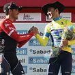 Winner of the 2017 Tour of the Basque country (Vuelta Ciclista al Pais Vasco) Movistar's Spanish rider Alejandro Valverde (R) shakes hands with second placed Trek's Spanish rider Alberto Contador as they celebrate on the podiumn of the last stage of the 2017 Tour of the Basque Country (Vuelta Ciclista al Pais Vasco), a 27.7km individual time trial circular route Eibar to Eibar, on April 8, 2017. / AFP PHOTO / CESAR MANSO