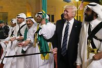(FILES) In this file photo taken on May 20, 2017, US President Donald Trump joins Saudi Arabia's King Salman bin Abdulaziz al-Saud (3rd L) and other dancers with swords at a welcome ceremony ahead of a banquet at the Murabba Palace in the Saudi capital Riyadh. - Brandishing a sword and dancing to traditional music on his first visit to Saudi Arabia soon after taking office, Donald Trump launched a dramatic relationship revamp that freed the hands of the Gulf monarchies. More than three years on, regional leaders are playing their diplomatic cards in support of an erratic but valuable partner in Washington as he seeks a second term - one that would likely lead to even deeper tensions with Iran and more opportunities for their one-time enemy, Israel. (Photo by MANDEL NGAN / AFP)