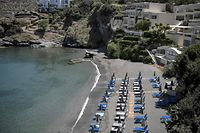 This photograph shows sunbeds on a beach in the fishing village of Bali near Heraklion town in the island of Crete on May 14, 2021. - Greece kickstarts its tourism season on May 14, 2021, with both the government and travel operators hoping the lure of sun, sand and sea will bring a sorely needed revenue boost after last year's miserable holiday season amid the covid-19 pandemic. (Photo by Louisa GOULIAMAKI / AFP)