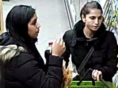 The two women shown here are suspected of having stolen the wallet.