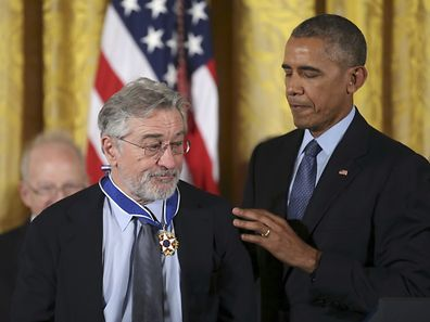 U.S.  President Barack Obama stands with actor Robert De Niro after presenting the Presidential Medal of Freedom to De Niro during a ceremony in the White House East Room in Washington, U.S., November 22, 2016.  REUTERS/Carlos Barria