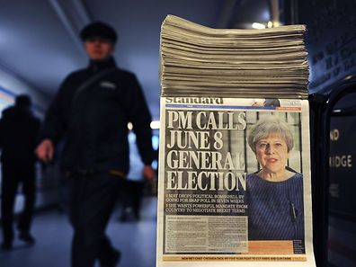 A newspaper stand shows a copy of today's Evening Standard, with the front page story relating to British Prime Minister Theresa May's call for a snap general election on June 8, in central London on April 18, 2017.  British Prime Minister Theresa May called Tuesday for a snap election on June 8, in a shock move as she seeks to bolster her position before tough talks on leaving the EU. May is apparently aiming to cash in on her 20-point lead over the main opposition Labour party to increase her majority and give her a stronger hand in the Brexit battles with Brussels ahead.  / AFP PHOTO / DANIEL SORABJI