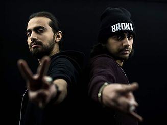 """TO GO WITH AFP STORY BY SIMON VALMARY  Members of the Palestinian-Syrian hip hop band """"Refugees of Rap"""", brothers Yaser (L) and Mohamed Jamous, pose in Paris on January 19, 2017. The two brothers born in the Palestinian refugee camp of Yarmuk near Damascus created the band with an Algerian and a Syrian friend in 2007, one of the first of its kind in Arabic in Syria. When the repression of the Syrian spring began in 2011 they wrote songs about conditions under the regime, but when the conflict reached Yarmuk and their studio destroyed in bombings, they left for France. / AFP PHOTO / PHILIPPE LOPEZ"""