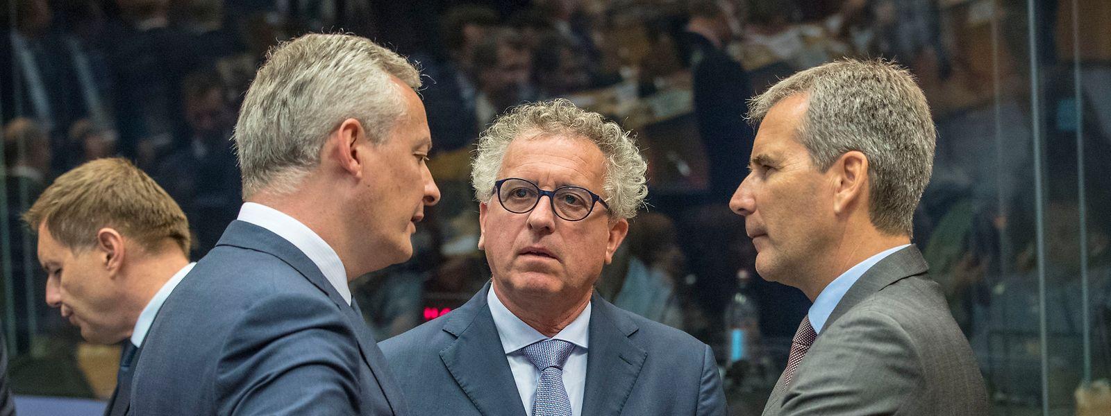 Les ministres des Finances de la France, Bruno Le Maire, du Luxembourg, Pierre Gramegna et de l'Autriche, Hartwig Loger.