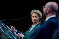 EU President of Council Charles Michel (R) and European Commission President Ursula von der Leyen (L) give a joint press conference after a G7 Leaders' videoconference on COVID-19 at the EU headquarters in Brussels on March 16, 2020. - Ursula von der Leyen on March 16 proposed that the EU close its borders to non-essential travel, as Europe scrambles to fight the spread of the coronavirus disease. Charles Michel will official propose the measure at an EU leaders summit on March 17 that will be held by videoconference. That meeting will come one day after the G7 holds a similar high-level videoconference. (Photo by Kenzo TRIBOUILLARD / AFP)