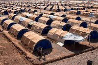 (FILES) This file photo taken on July 12, 2017 shows a general view of the UNHCR (United Nations High Commissioner for Refugees) refugee camp in Hammam al-Alil, on the outskirts of Mosul. 2017 will be remembered as the year the Islamic State organisation's ultra-violent experiment in statehood was terminated but Iraq and Syria are left staring at ruined cities and daunting challenges. / AFP PHOTO / FADEL SENNA