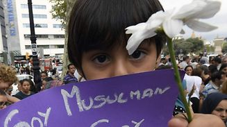 "Omar, 4 year-old, holds a message reading ""I a Muslim, not a terrorist"" as Muslim residents of Barcelona demonstrate on the Las Ramblas boulevard in Barcelona, to protest against terrorism and in tribute to the victims of the Barcelona attack on August 19, 2017, two days after a van ploughed into the crowd, killing 13 persons and injuring over 100. Drivers have ploughed on August 17, 2017 into pedestrians in two quick-succession, separate attacks in Barcelona and another popular Spanish seaside city, leaving 14 people dead and injuring more than 100 others. / AFP PHOTO / LLUIS GENE"