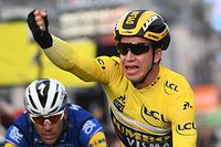 Netherlands' Dylan Groenewegen, wearing the overall leader's yellow jersey, celebrates as he crosses the finish line ahead of Belgium's Philippe Gilbert (L) at the end of the 163,5km 2nd stage of the 77th Paris-Nice cycling race between Les Breviaires and Bellegarde, on March 11, 2019 in Bellegarde. (Photo by Anne-Christine POUJOULAT / AFP)