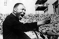 American Civil Rights and religious leader Dr Martin Luther King Jr (1929 - 1968) gestures emphatically during a speech at a Chicago Freedom Movement rally in Soldier Field, Chicago, Illinois, July 10, 1966. (Photo by Afro American Newspapers/Gado/Getty Images)