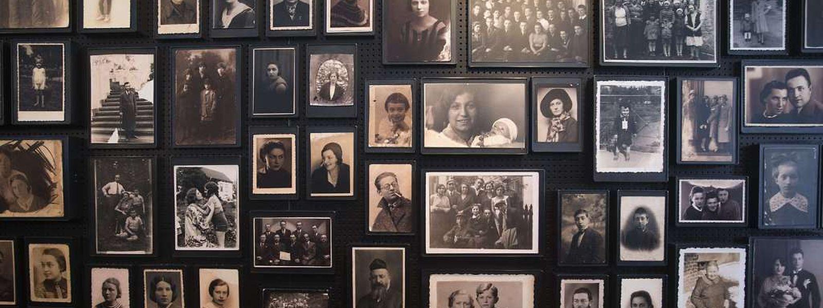 Fotos von Opfern des Nazi-Terrors. 300 Überlebende werden heute in Auschwitz sein, um Zeugnis von dem Grauen abzulegen.