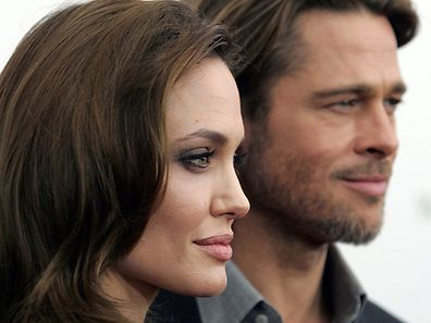 "Angelina Jolie and Brad Pitt arrive at the screening of her directorial debut ""In the Land of Blood and Honey"" in New York December 5, 2011.     REUTERS/Carlo Allegri/File Photo"