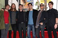 (FILES) In this file photo taken on February 10, 2017 recording artist Adam Levine (3rd L) poses with his band Maroon 5 after he was honored with a Star on the Hollywood Walk of Fame in Hollywood, California. - The NFL on January 29, 2019 cancelled its traditional pre-Super Bowl press conference with stars of its halftime show amid reported criticism in the music world over the treatment of former San Francisco 49ers quarterback Colin Kaepernick. Three-time Grammy Award-winning band Maroon 5 will headline the halftime concert in Atlanta on Sunday, one of the highlights of the biggest event on the US sporting calendar. (Photo by Mark RALSTON / AFP)