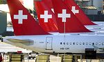 Passenger planes of the Swiss airline 'Swissair' stand on the tarmac of the Zurich, Switzerland, Kloten Airport on Monday, Oct. 22, 2001. The Swiss parliament on Monday was deciding on financial support for and the future of  the troubled Swiss flag carrier. (AP Photo/Steffen Schmidt, KEYSTONE)