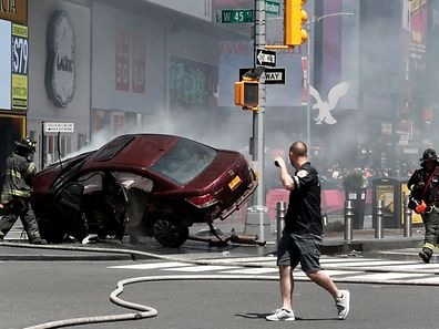 A vehicle that struck pedestrians and later crashed is seen on the sidewalk in Times Square in New York City, U.S., May 18, 2017. REUTERS/Mike Segar     TPX IMAGES OF THE DAY