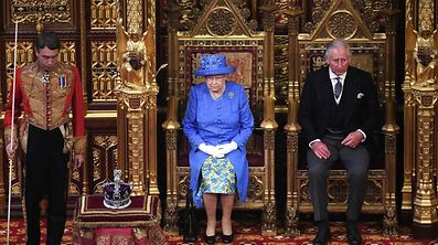 Britain's Queen Elizabeth II sits alongside her son Britain's Prince Charles, Prince of Wales, before delivering the Queen's Speech during the State Opening of Parliament in the Houses of Parliament in London on June 21, 2017.