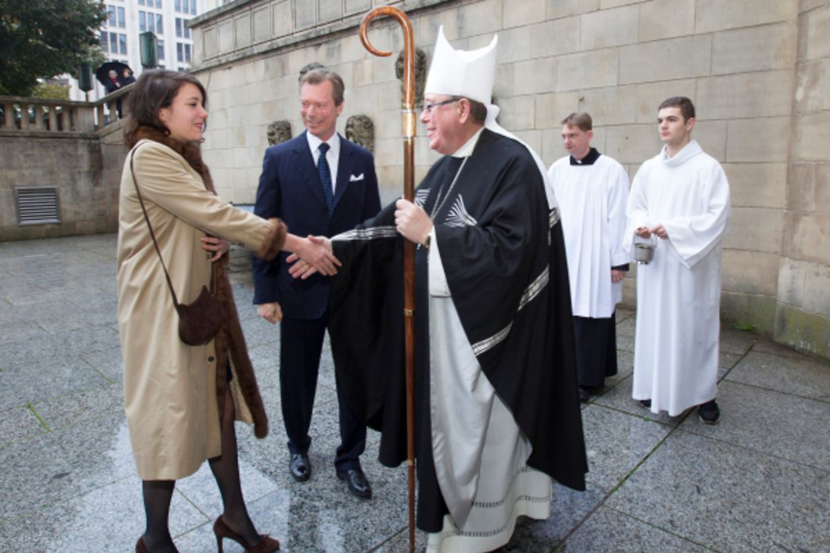 Luxembourg's Princess Alexandra shakes hands with Luxembourg's Archbishop, Jean-Claude Hollerich at Notre Dame Cemetery in Limpertsberg