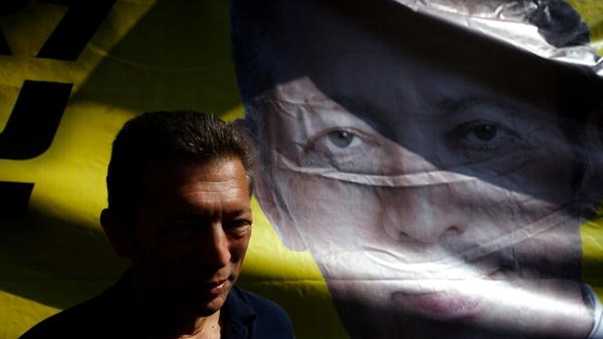 Israeli-Russian billionaire Arkady Gaydamak stands in front of a campaign poster whilst on a tour of Jerusalem on October 31, 2008. Gaydamak, who is hoping to be elected mayor of Jerusalem in the November 11 municipal elections in Israel, declared earlier in the week that he planned to testify at the trial of French politicians over the so-called Angola-gate arms deal scandal.