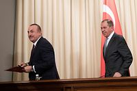 Russian Foreign Minister Sergei Lavrov and his Turkish counterpart Mevlut Cavusoglu hold a joint press conference following the talks on a ceasefire deal between the warring sides in Libya, in Moscow on January 13, 2020. (Photo by Pavel Golovkin / POOL / AFP)