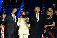 TOPSHOT - US President-elect Joe Biden (R) and Vice President-elect Kamala Harris (2nd L) react as confetti falls, with Jill Biden (R) and Douglas Emhoff, after delivering remarks in Wilmington, Delaware, on November 7, 2020, after being declared the winners of the presidential election. (Photo by Jim WATSON / AFP)