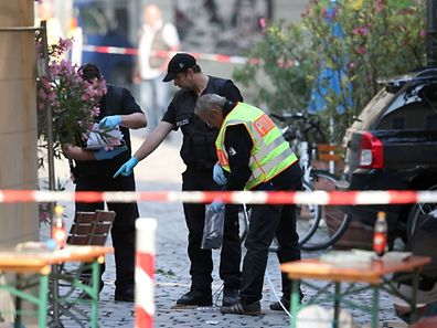 Police investigators work at the site of a suicide bombing in Ansbach, southern Germany, on July 25, 2016.  A failed Syrian asylum seeker set off an explosive device near an open-air music festival in the southern city of Ansbach that killed himself and wounded a dozen others. / AFP PHOTO / dpa / Daniel Karmann / Germany OUT