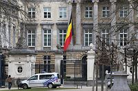 The Belgian flag flies at half-mast at the Palais de la Nation near the Wetstraat (Rue de la Loi) which was evacuated after an explosion at the Maalbeek subway station in Brussels on March 22, 2016. European countries vowed to defend democracy against terrorism after blasts at Brussels airport and in the EU's institutional heart left at least 26 dead and dozens injured. / AFP / Belga / NICOLAS MAETERLINCK / Belgium OUT