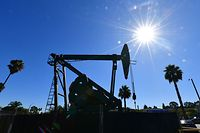 (FILES) In this file photo taken on October 21, 2019 a pumpjack from California-based energy company Signal Hill Petroleum is seen in Signal Hill, California. - The US benchmark crude oil price sank to its lowest level ever on April 20, 2020, falling below $10 a barrel amid the coronavirus pandemic's hit to demand and an epic supply glut.Around 1650 GMT, West Texas Intermediate (WTI) for May delivery hit $7.90 per-barrel in New York trading. (Photo by Frederic J. BROWN / AFP)