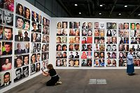 """Visitors discover """"Rob Pruittís Official Art World / Celebrity Look-alikes Series"""" by US conceptual artist Rob Pruitt at Unlimited show during the preview day of Art Basel, the world's premier modern and contemporary art fair, on June 13, 2017 in Basel. Art Basel will take place from June 15 to 18 in Basel. / AFP PHOTO / Fabrice COFFRINI / RESTRICTED TO EDITORIAL USE - MANDATORY MENTION OF THE ARTIST UPON PUBLICATION - MANDATORY CREDIT """"AFP PHOTO / SOURCE / BYLINE"""" -  TO ILLUSTRATE THE EVENT AS SPECIFIED IN THE CAPTION - NO MARKETING NO ADVERTISING CAMPAIGNS - DISTRIBUTED AS A SERVICE TO CLIENTS - NO ARCHIVE /"""