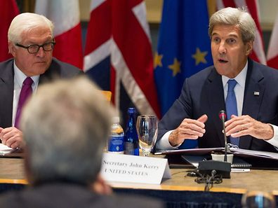 German Foreign Minister Frank-Walter Steinmeier (L) listens in as US Secretary of State John Kerry (R) makes opening remarks during a ministerial meeting at Tufts University in Medford, Massachusetts on September 24, 2016.   / AFP PHOTO / Matthew Healey