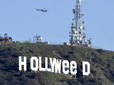 """The famous Hollywood sign reads """"Hollyweed"""" after it was vandalized, January 1, 2017"""