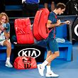 Switzerland's Roger Federer (R) walks off the court after losing to Greece's Stefanos Tsitsipas during their men's singles match on day seven of the Australian Open tennis tournament in Melbourne on January 20, 2019. (Photo by DAVID GRAY / AFP) / -- IMAGE RESTRICTED TO EDITORIAL USE - STRICTLY NO COMMERCIAL USE --