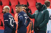 Istanbul Basaksehir's French forward Demba Ba (R) gestures past Paris Saint-Germain's Brazilian forward Neymar (L) and Paris Saint-Germain's French forward Kylian Mbappe after the game was suspended amid allegations of racism by one of the match officials during the UEFA Champions League group H football match between Paris Saint-Germain (PSG) and Istanbul Basaksehir FK at the Parc des Princes stadium in Paris, on December 8, 2020. - Paris Saint-Germain's decisive Champions League game with Istanbul Basaksehir was suspended today in the first half as the players walked off amid allegations of racism by one of the match officials. The row erupted after Basaksehir assistant coach Pierre Webo, the former Cameroon international, was shown a red card during a fierce row on the touchline with staff from the Turkish club appearing to accuse the Romanian fourth official of using a racist term. (Photo by FRANCK FIFE / AFP)
