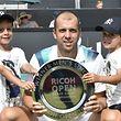 Nils und Lenny waren auch beim zweiten Turniersieg ihres Vaters Gilles Muller vor Ort.