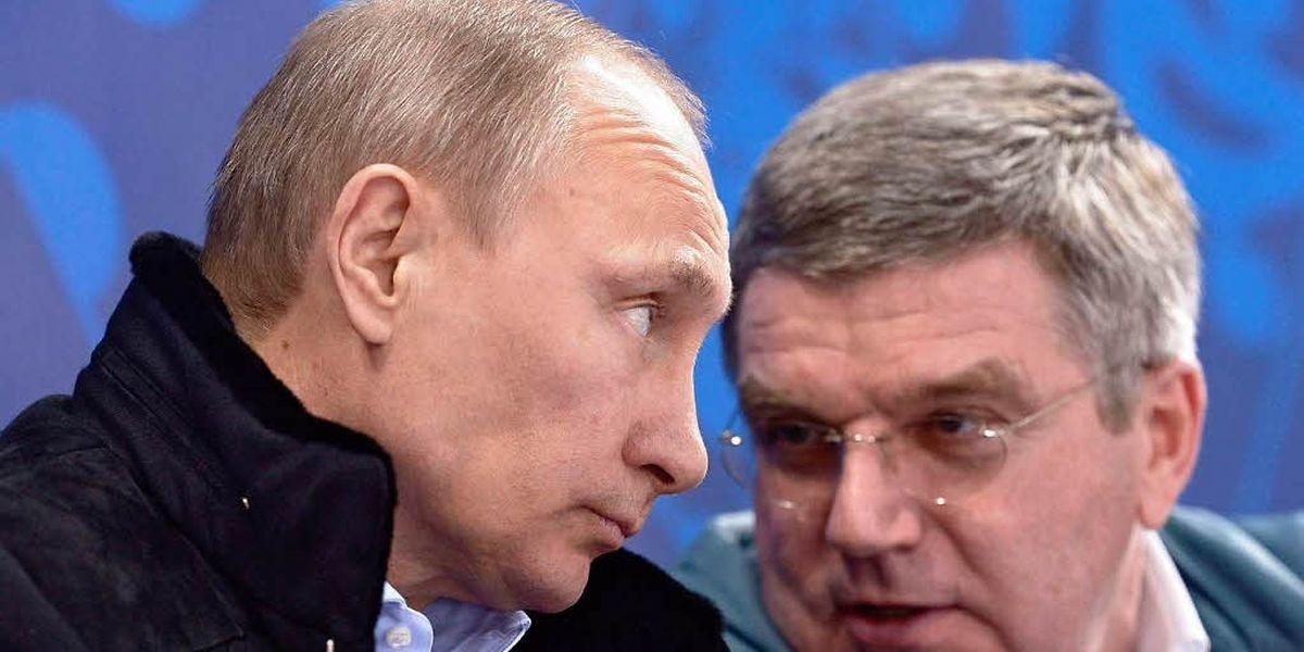 Was weiß Vladimir Putin (l., mit IOC-Präsident Thomas Bach)?