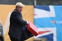 Britain's Foreign Secretary Boris Johnson arrives at the Midland Hotel on the first day of the Conservative Party annual conference held at the Manchester Central Convention Centre, in Manchester on October 1, 2017. British Prime Minister Theresa May's Conservative Party gathers on October 1, 2017, for its annual conference, dominated by questions about her leadership and splits on Brexit. / AFP PHOTO / Oli SCARFF