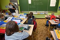Children attending Gounod-Lavoisier school return to school on September 2, 2021, on the first day of the French school year. - Lille's 12,500 schoolchildren will benefit from free school supplies, financed by the city. (Photo by DENIS CHARLET / AFP)